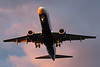 A US Airways E-190 on a sunset final for runway 27.