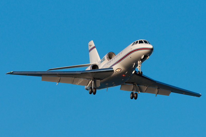 A Falcon 2000 on final for runway 27.