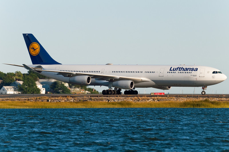 The Lufthansa A340 has just arrived and is taxiing towards the gates.
