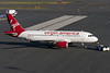 The towbar is disconnected and the Virgin A319 is ready for taxi.