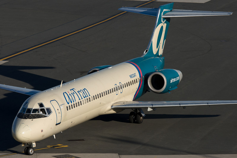 An AirTran 717 pulls up to a gate at Terminal C.