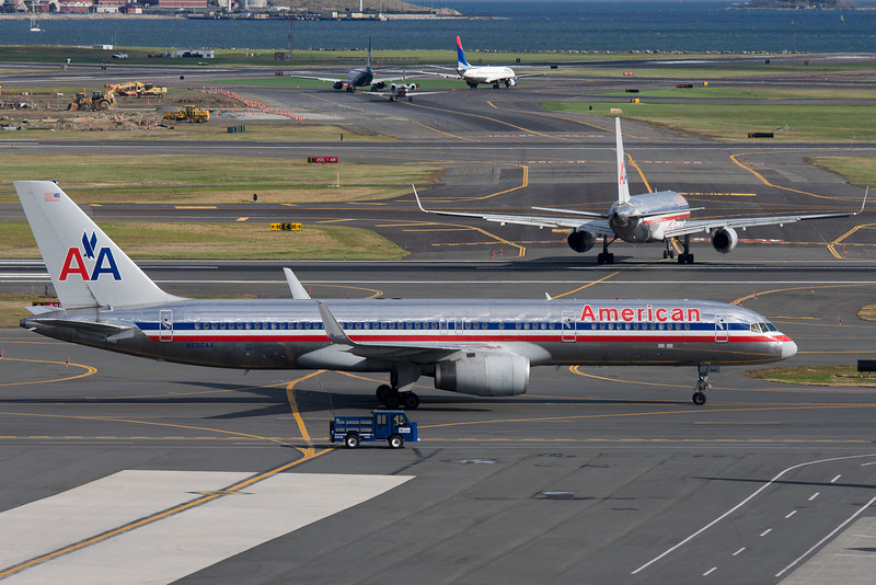 An American 757 taxis towards its gate with a company 757 on its way to join the conga line for runway 27 departures.
