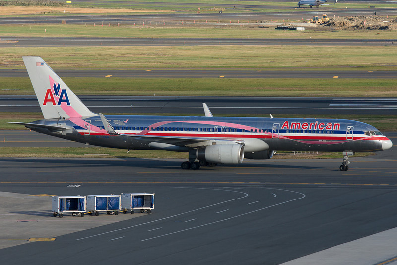 This American 757 is in the Susan G. Komen breast cancer awareness livery.