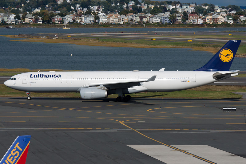The Lufthansa Airbus A330 has arrived from Frankfurt and is taxiing towards its gate at Terminal C.