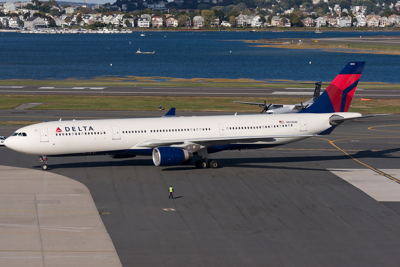 Delta's Airbus A330 taxiing towards the gate at Terminal E.