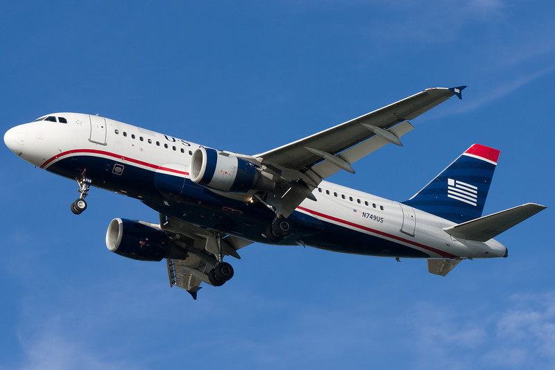 Another US Airways A319 on final for runway 27.