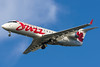 Air Canada Jazz CRJ-200 on final for runway 27.