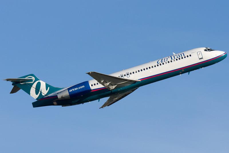 An AirTran 717 departs Logan airport via runway 22R.