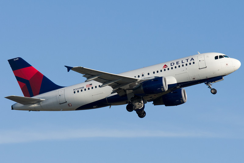 A Delta colors Airbus A319 departing from runway 22R.