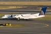 A Colgan Continental Express Q400 taxiing for departure on 22R.