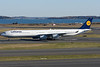 A veritable pencil, the Lufthansa A340-600 taxis to the international arrivals terminal via runway 4L.