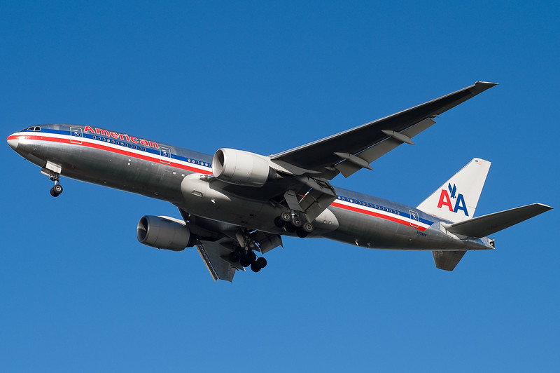 The American 777 is on final for runway 27.