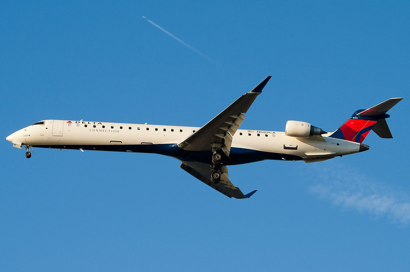 A DL 737 is flying high above this Comair CRJ-900.