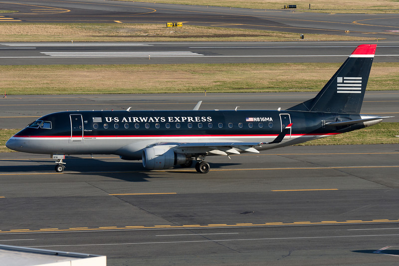 A US Airways Express E-170, operated by Republic airlines, taxiis for departure.