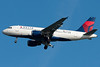 A Freshly painted Delta Airbus on final for runway 04R.