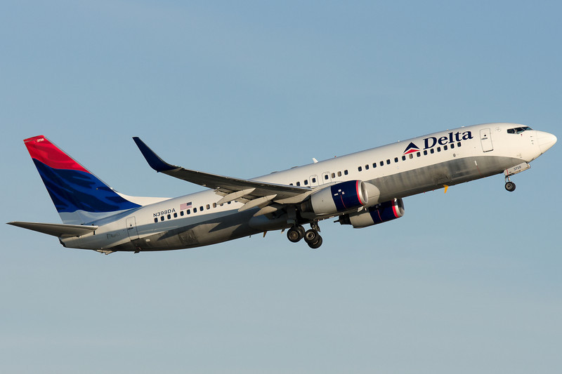 A Delta 737-800 with winglets departs runway 22R at BOS.