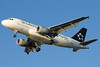 The US Airways A319 is decked out in the Star Alliance scheme.
