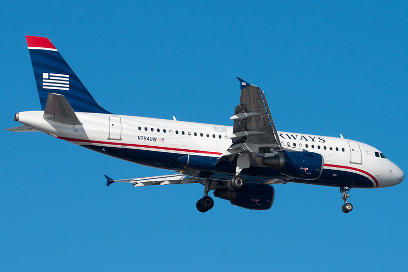 Now painted in the new US Airways colors. Seen on final for runway 4R.