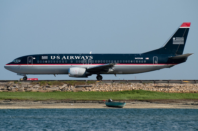 A US 737 is ready to turn onto runway 22R.