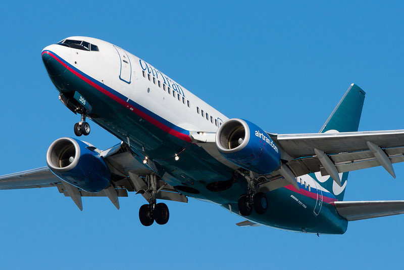 Hey, it's an AirTran 737. Never seen one of THOSE before.