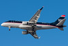 A Republic E-170 in US Airways Express colors is on final for runway 27.