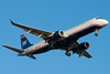 A US Airways Embraer E-190 on final for runway 27.