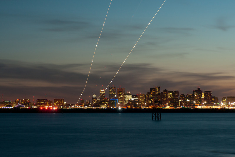 An American 757 arrives at Logan airport, creating a stream of light.