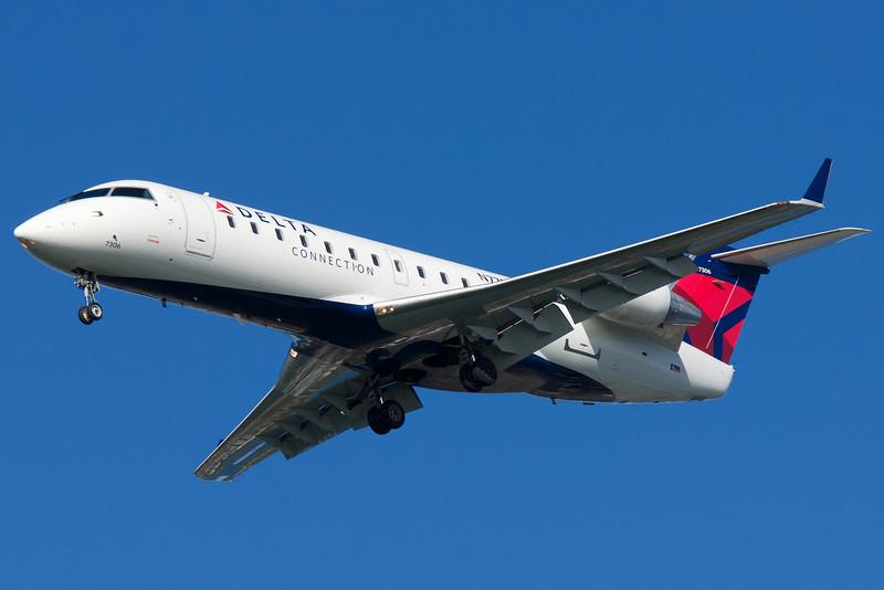 A Comair CRJ-200 on final for 27.
