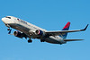 A Delta 737 on final for runway 27.