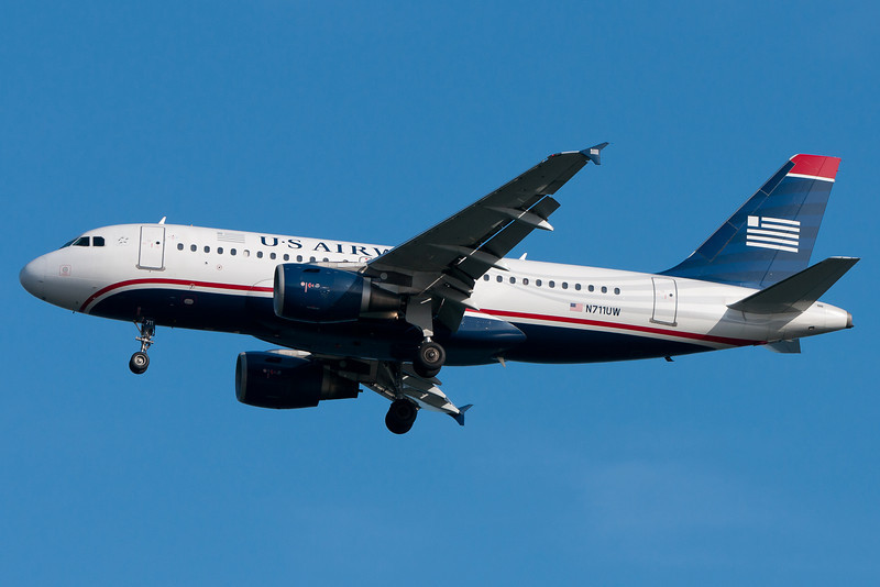 The US Airways Airbus A319 on final for runway 04R.