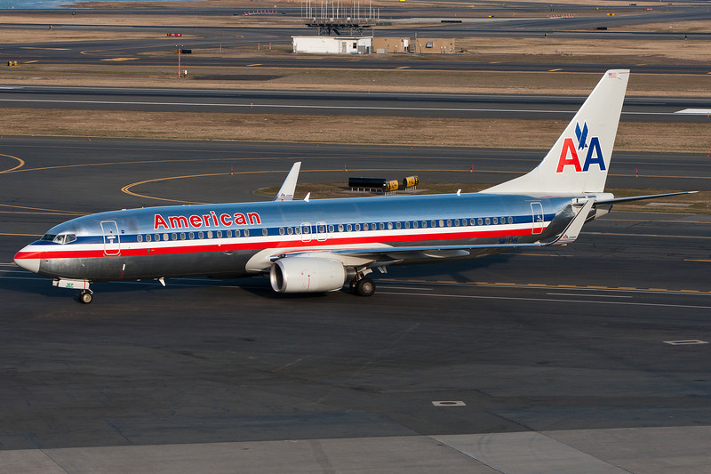 This American 737-800 heads for its gate with a 757 to follow.