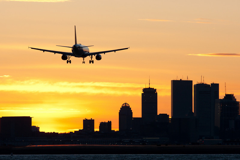 This JetBlue Airbus A320 is on final for runway 27 in the deep sunset colors.