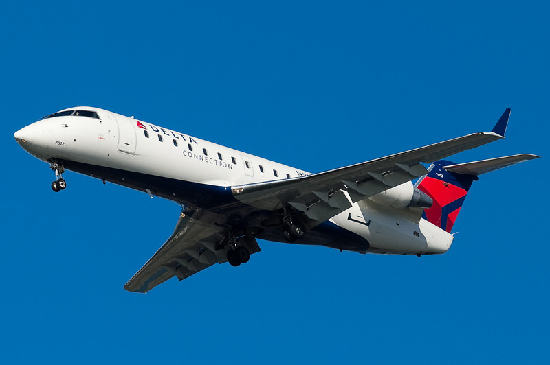 A Comair CRJ is on final for 27.