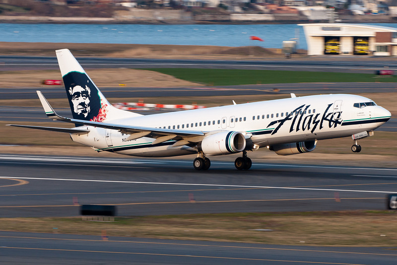 This Alaskan 737 sports a lei as it departs runway 22R.