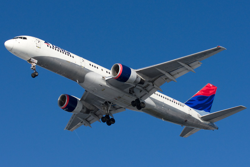 A Delta 757 on final for runway 27.