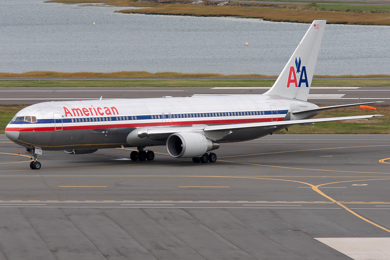 The American 767 from Heathrow arrives and taxis towards terminal E.