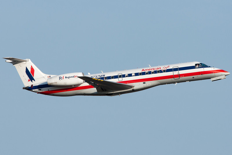 American Eagle flies away from Logan airport.