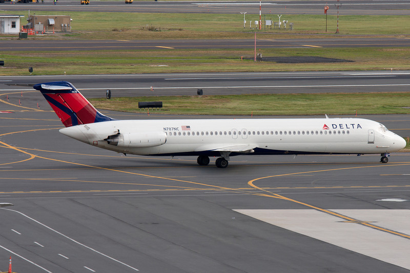 A Northwest DC-9 now in Delta colors taxis towards terminal A.