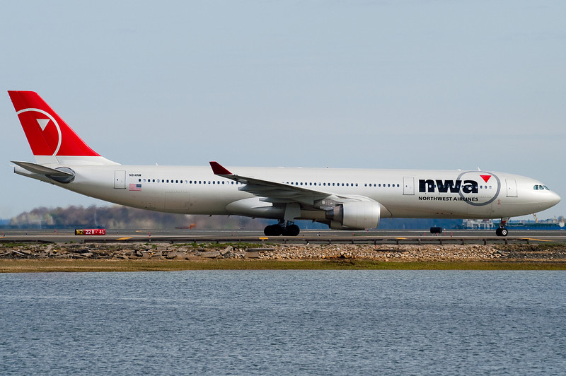 A Northwest A330 taxiing to the gates.