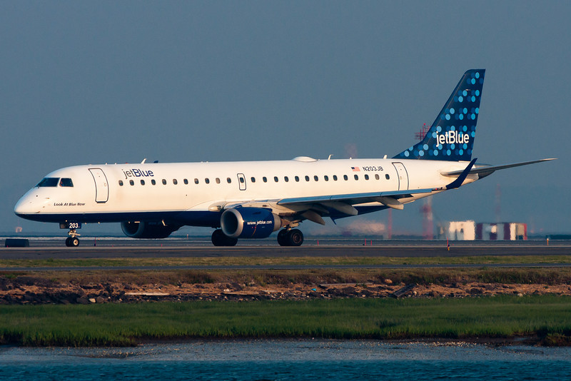 A JetBlue E-190, Look At Blue Now, taxiing for departure.
