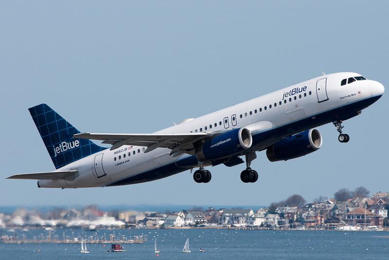A JetBlue A320 departs Logan's runway 22R.