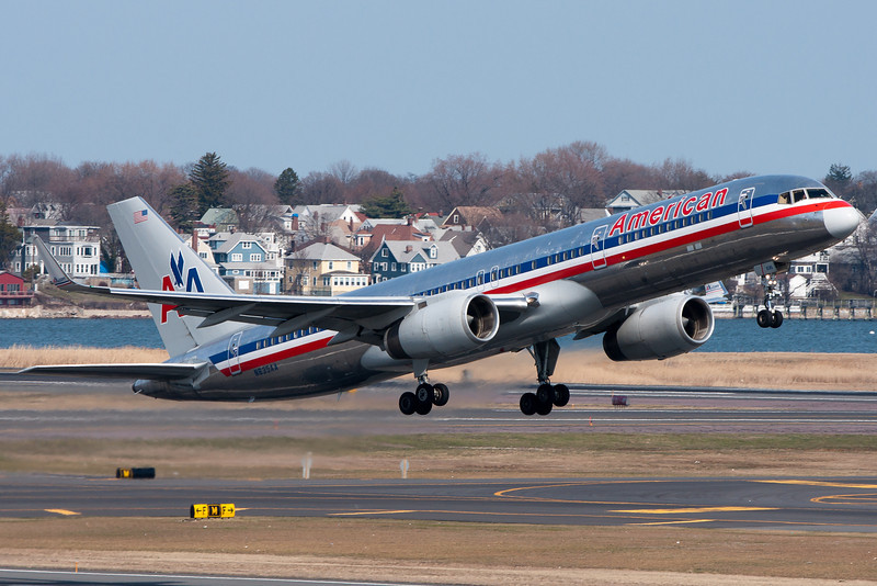 An American 757 with winglets taking off from runway 22R.
