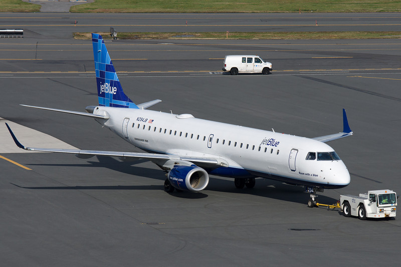 Room with a Blue, a jetBlue Embraer E-190, is being towed to its gate at Terminal C.