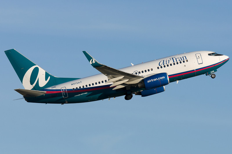 AirTran's 737-700 leaves Boston as the evening hours start setting in.
