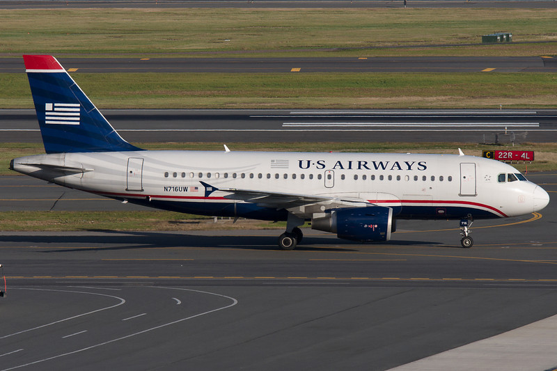 A US Airways Airbus A319 taxis towards its gate at Terminal B.