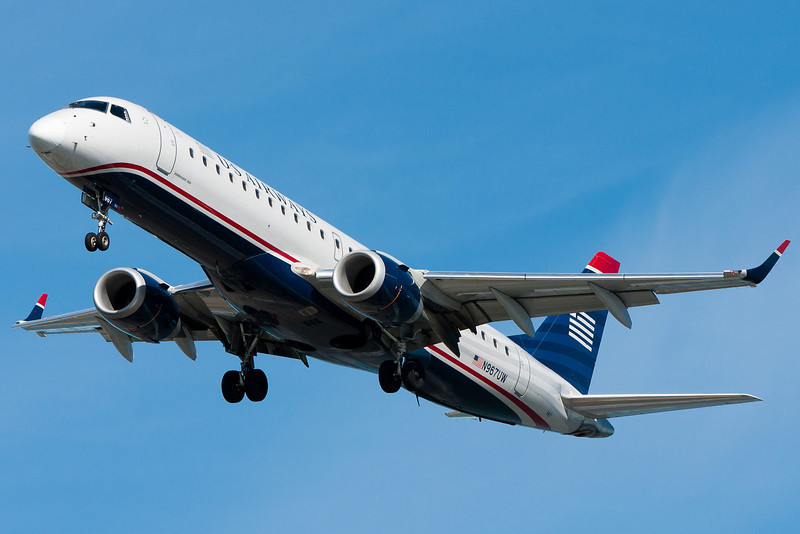 The first photograph with my new lens just so happened to be the same subject as my first photograph with my a700 when I first got it - a US Airways E-190.