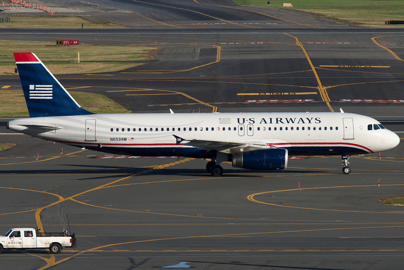 A US Airways A320 taxis towards the gate.