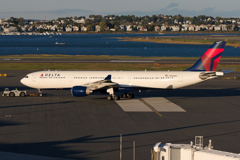 The Delta A330 pushes back from its gate for a tow to terminal A to pick up passengers for its return flight to Amsterdam.