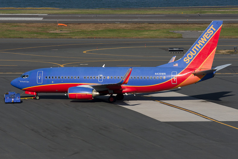 """Pushback for taxi for """"Donald G. Ogden,"""" a Southwest 737 with a commemorative sticker on the nose."""