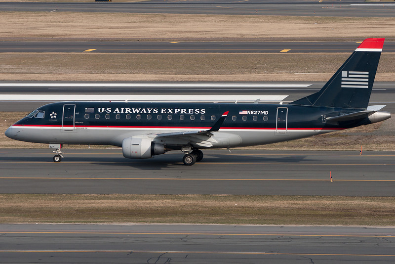 US Airways Express Embraer E-170 is taxiing for departure.